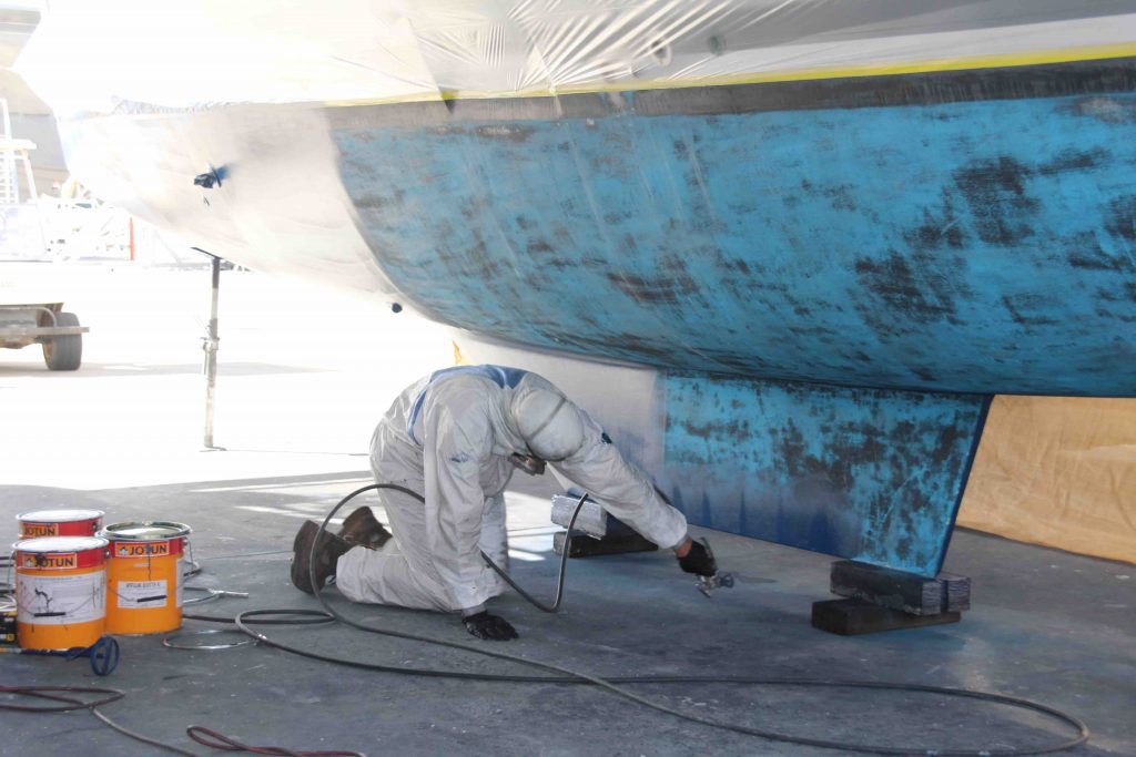 Affordable Antifoul giving the hulls a coat of paint.